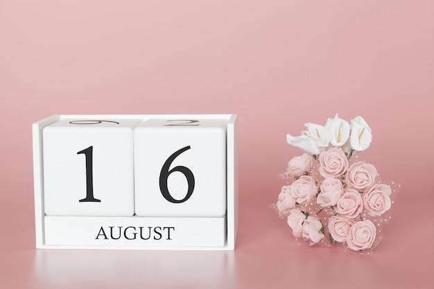 16 août. jour 16 du mois. cube de calendrier sur fond rose moderne, concept de commerce et événement important.