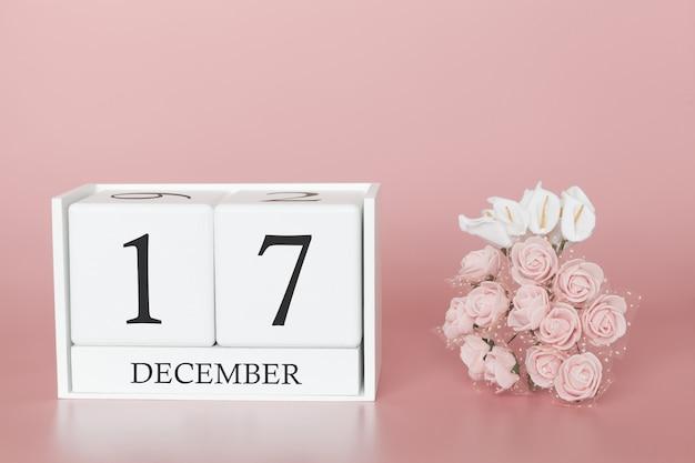 17 décembre. jour 17 du mois. cube de calendrier sur fond rose moderne, concept de commerce et événement important.