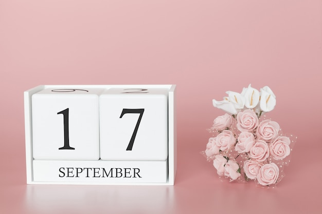 17 septembre. jour 17 du mois. cube de calendrier sur fond rose moderne, concept de commerce et événement important.