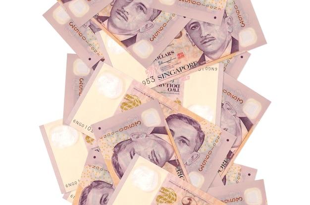 2 billets de dollars singapouriens volant vers le bas isolés. de nombreux billets