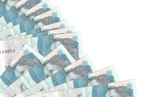 2 factures de pesos colombiens se trouvent isolés empilés dans le ventilateur de près. concept de temps de paie ou opérations financières