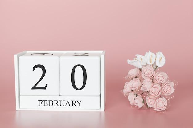 20 février. jour 20 du mois. cube de calendrier sur fond rose moderne, concept de commerce et événement important.