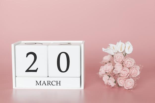 20 mars. jour 20 du mois. cube de calendrier sur rose moderne