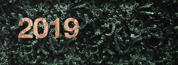 2019 bonne année sur le mur de feuilles vertes