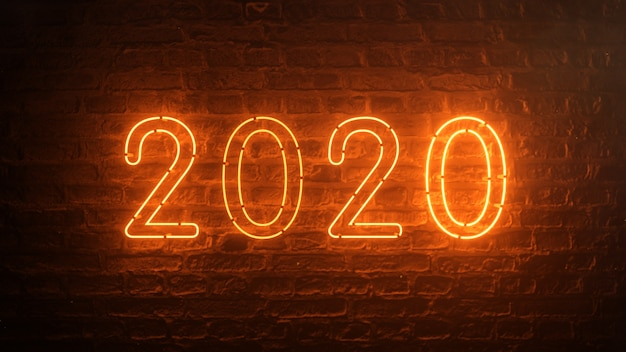 2020 feu orange néon signe fond nouvel an concept. bonne année. fond de brique. lumière scintillante.