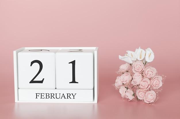 21 février. jour 21 du mois. cube de calendrier sur fond rose moderne, concept de commerce et événement important.