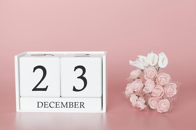 23 décembre. jour 23 du mois. cube de calendrier sur fond rose moderne, concept de commerce et événement important.