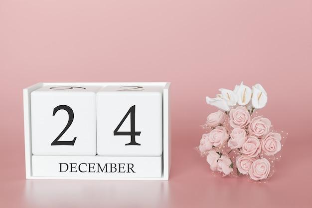 24 décembre jour 24 du mois. cube de calendrier sur fond rose moderne, concept de commerce et événement important.
