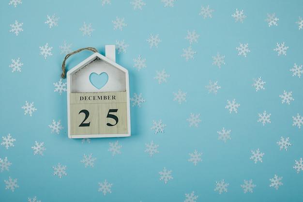 25 décembre vacances de noël. décor de fête confettis brillants.