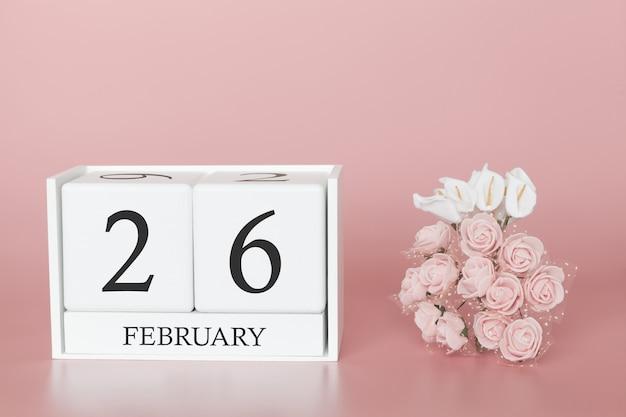 26 février. jour 26 du mois. cube de calendrier sur fond rose moderne, concept de commerce et événement important.