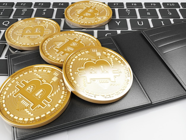 3d pile de pièces d'or bitcoin sur un clavier d'ordinateur