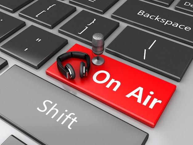 3d word air avec un micro et un casque sur le clavier de l'ordinateur.