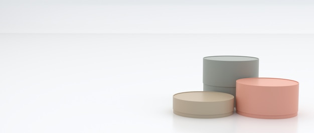 3e boîtes cylindriques de différentes tailles, couleurs pastel au sol et blanc