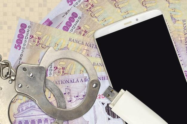 50000 factures de leu roumain et smartphone avec des menottes de police