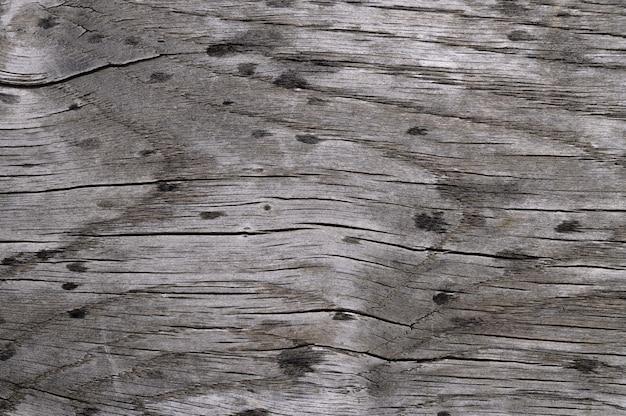 Abstrait de l'ancienne surface en bois avec des gouttes de pluie. vue de dessus en gros plan