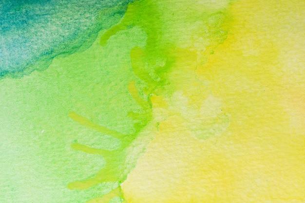 Abstrait aquarelle verte, jaune et turquoise. peinture à la main