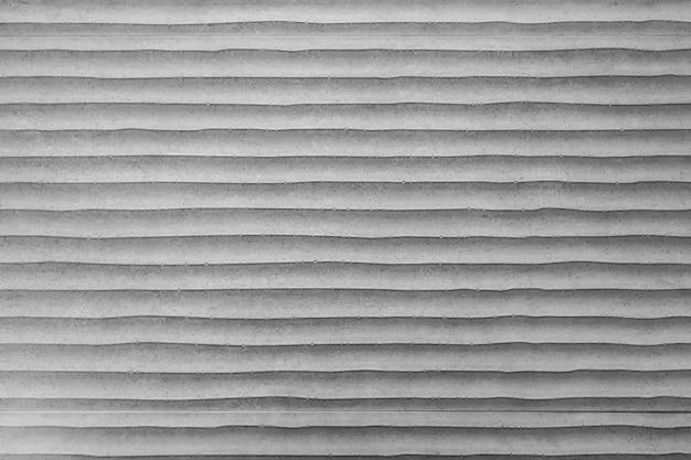 Abstrait de blanc peint sur un mur de béton avec grunge et rayé.