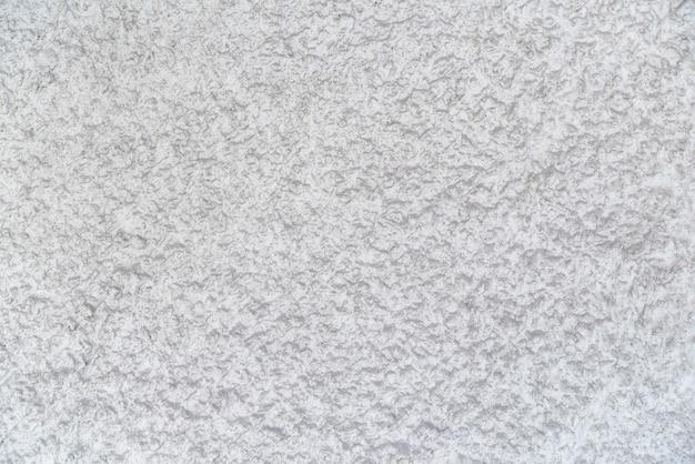 Abstrait blanc. texture rugueuse. plâtre sur le mur.