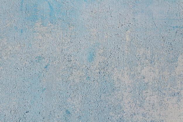Abstrait bleu doux avec de la peinture craquelée.