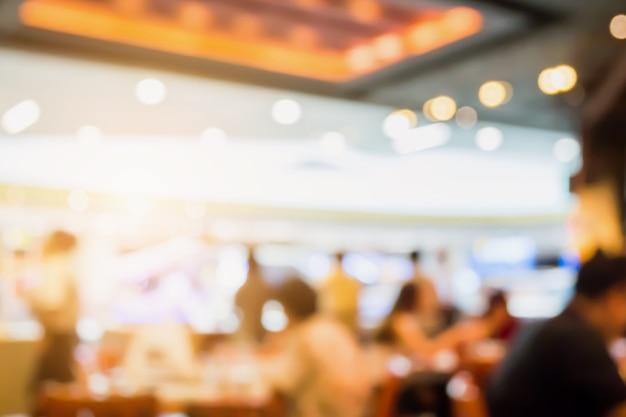 Abstrait café café restaurant intérieur flou fond avec lumière bokeh
