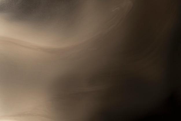 Abstrait, conception cinématographique de texture de fumée d'or