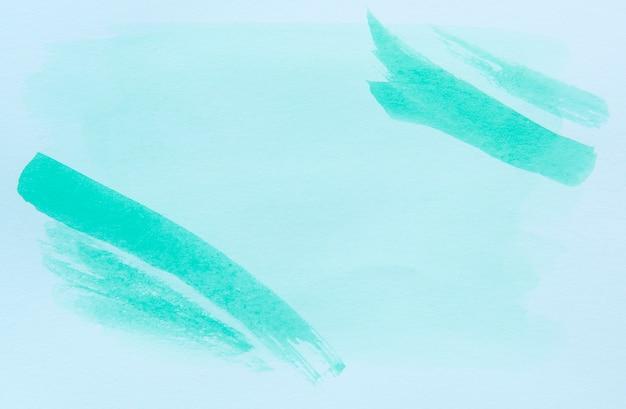 Abstrait de couleur vert clair peint sur du papier blanc.