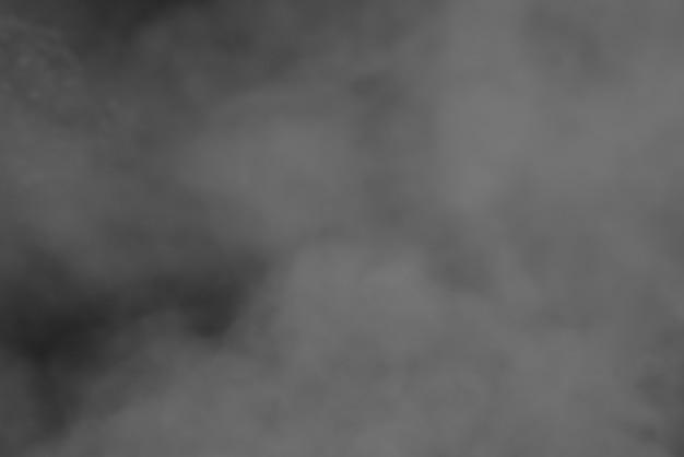 Abstrait courbes de fumée de fond et vague sur fond noir