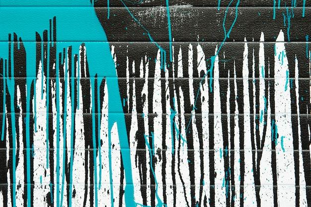 Abstrait des éclaboussures de peinture bleue et noire