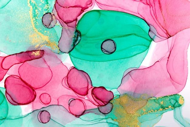 Abstrait d'encre alcool. texture aquarelle de style floral. illustration de taches de peinture rose, verte et or.