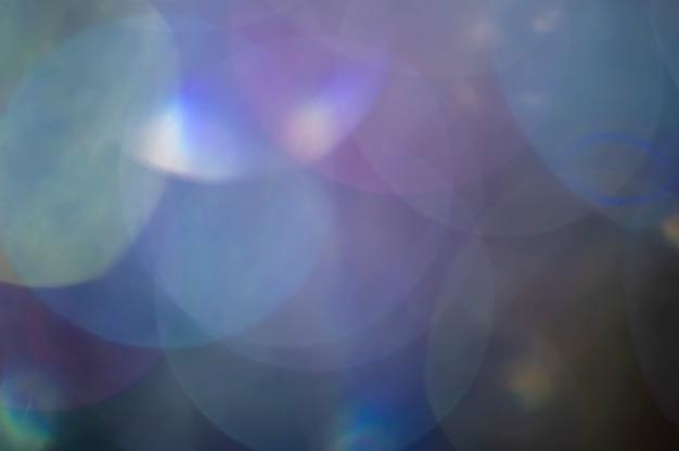 Abstrait flou brillant paillettes lampe s'allume en arrière-plan.