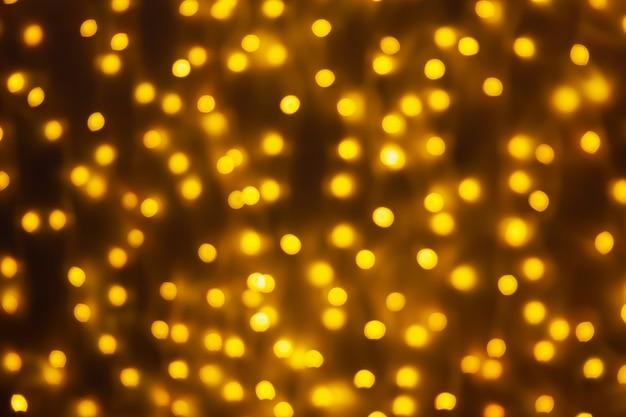 Abstrait flou doré bokeh lumière fond de vacances de noël