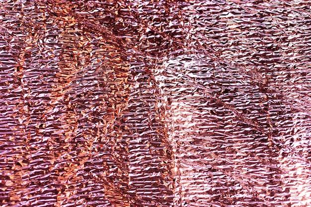 Abstrait flou fond de texture de feuille irisée holographique. couleurs argentées sirène à la mode néon vibrant futuriste