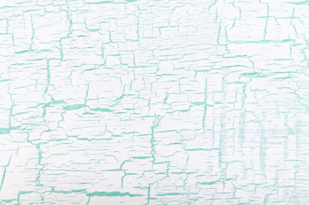 Abstrait fond craquelé peint en blanc et vert.