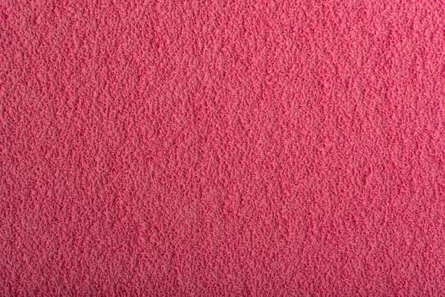 Abstrait de framboise. surface rose texturée rugueuse.