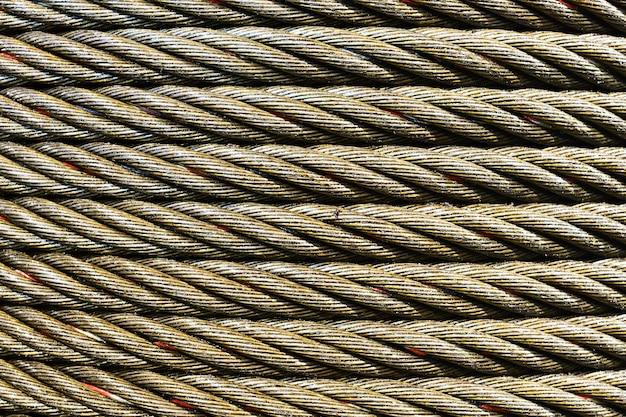 Abstrait industriel. photo en gros plan de câble en acier. nouveau graissage de corde.