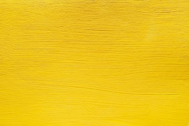 Abstrait jaune de peintures acryliques. fond de béton.