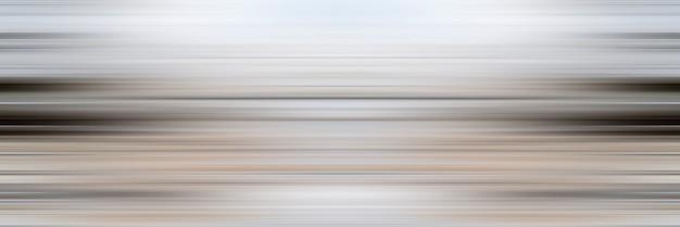 Abstrait de lignes horizontales. les traînées sont floues en mouvement.