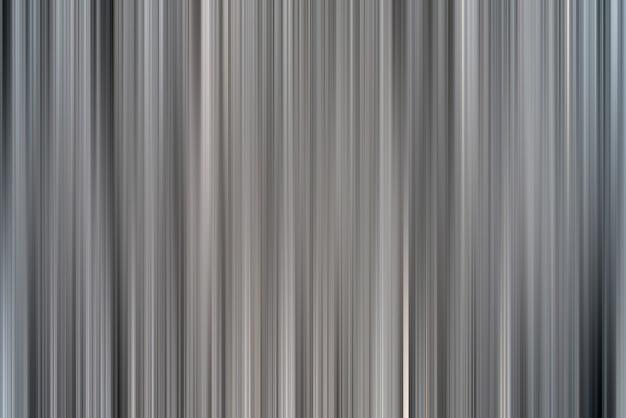 Abstrait de lignes roses verticales. les stries sont floues en mouvement.