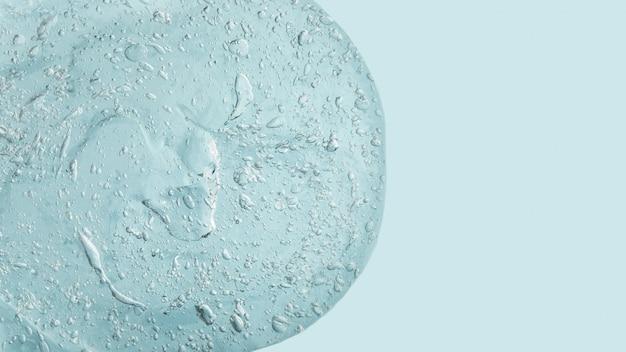 Abstrait liquide bleu. texture de gel épais qui coule avec beaucoup de bulles.