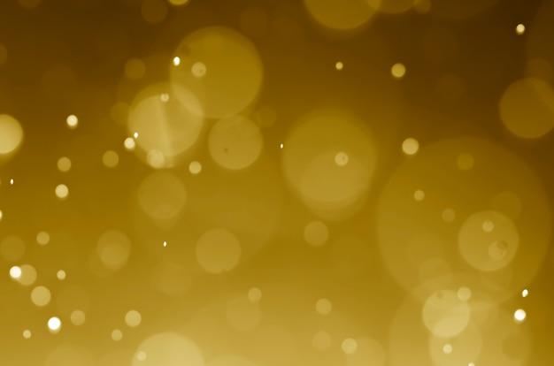 Abstrait d'or foncé avec bokeh.
