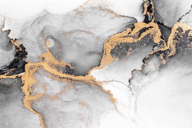 Abstrait or noir de peinture d'art à l'encre liquide en marbre sur papier.