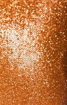 Abstrait or et rouge avec bokeh, lumières défocalisées. notion festive.