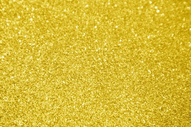 Abstrait paillettes d'or sparkle bokeh fond clair