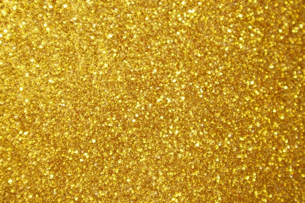 Abstrait paillettes d'or sparkle bokeh fond clair