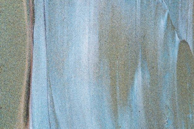 Abstrait de paillettes vert bleu foncé. fond aigue-marine avec texture de paillettes bleues scintillantes. espace de copie