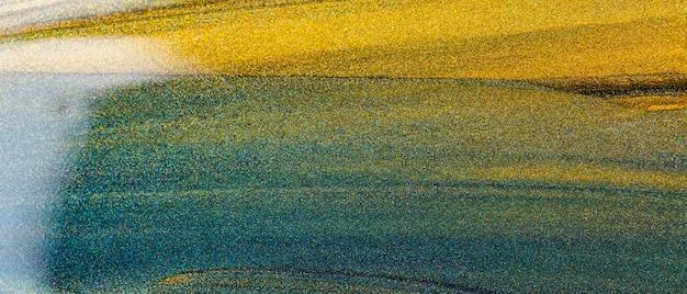 Abstrait De Paillettes Vertes Dorées. Texture De Paillettes Orange Vert. Toile De Fond Scintillante De Vacances Photo Premium