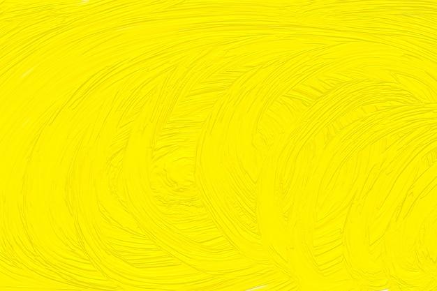 Abstrait peint en jaune, motif. texture tachée, toile d'art, conception de peinture. papier peint à l'aquarelle. encre brillante. modèle de créativité, couleur moderne, peinture maculée sur papier.