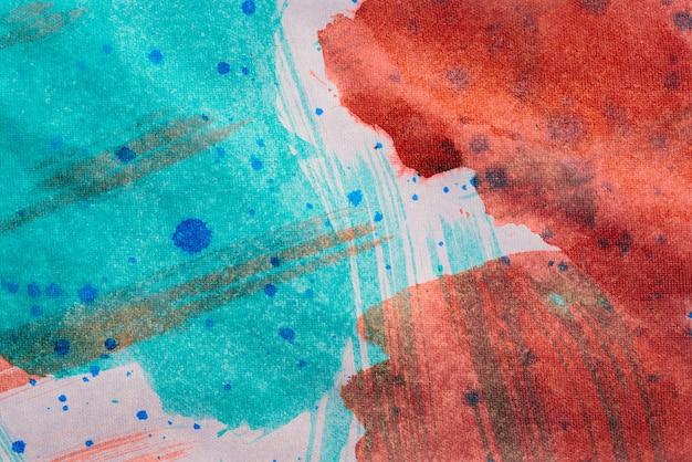 Abstrait avec de la peinture acrylique sur toile, fond grunge avec un espace pour le texte ou l'image, taches de peinture aquarelle, texture lumineuse colorée.