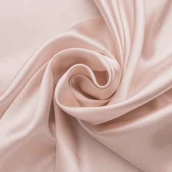Abstrait de soie lisse, texture satinée pliée.