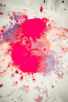 Abstrait de taches rose, rouge et marron